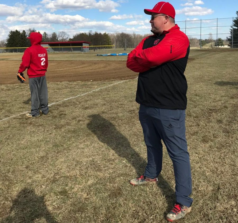 Coach Carrier observes his team warming up.