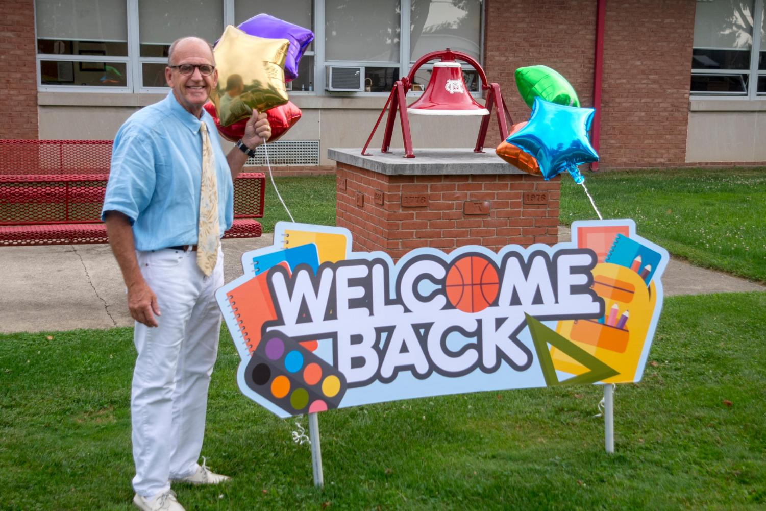 Mr. Sutter poses on the first day of school outside on the front lawn.