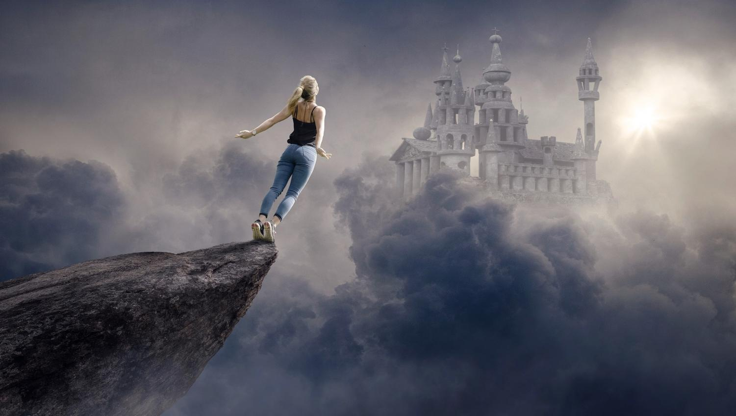 A woman on the edge of a cliff