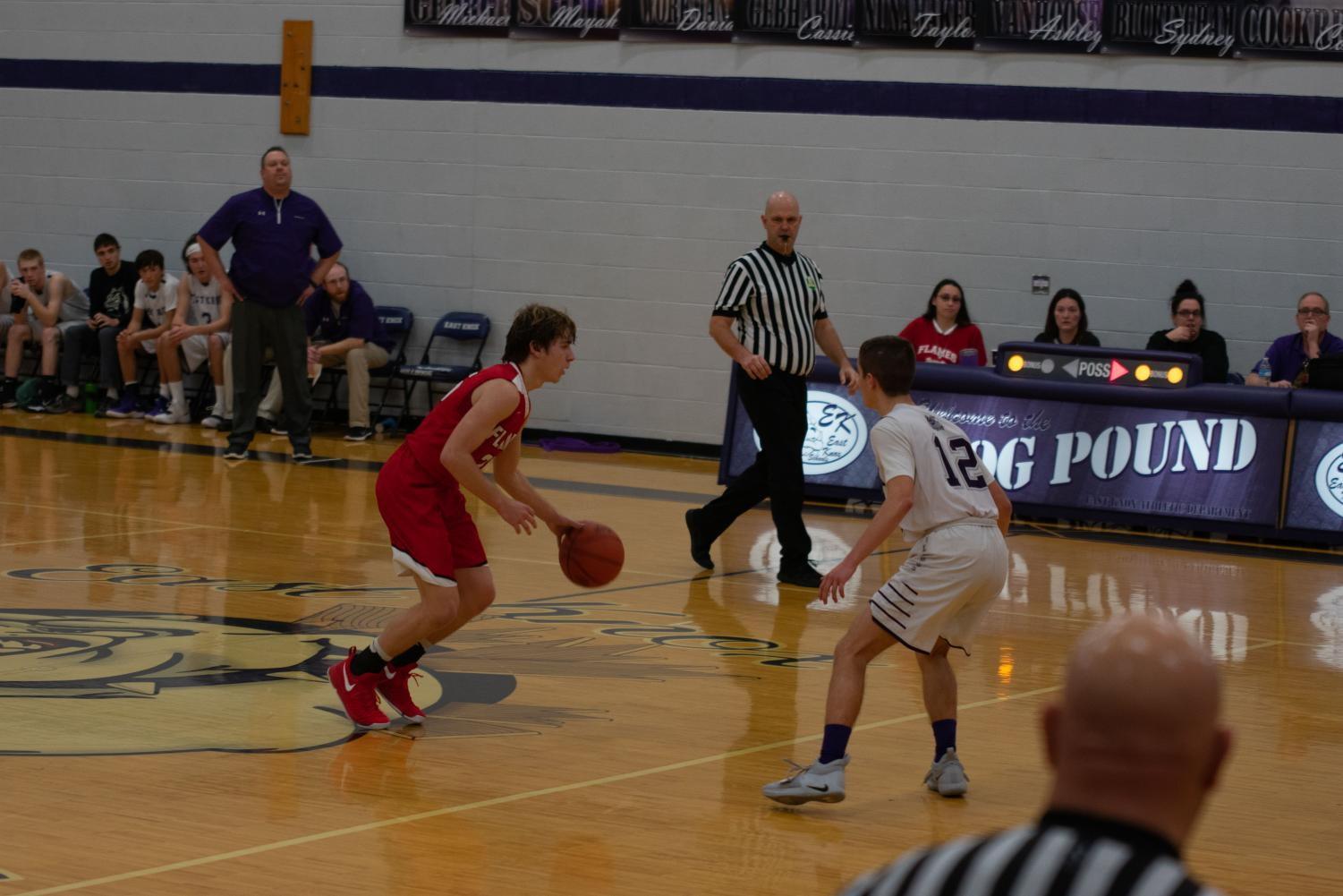 Jared Mount brings the ball down the court in the Bulldogs' gym.