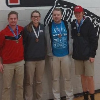 Addison, Audrey, Garrett, and TC show off their medals from the Physics Olympics.