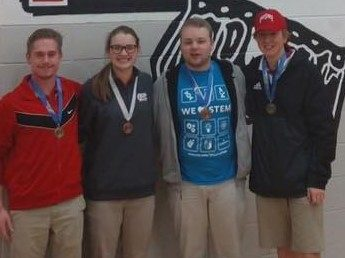 Addison, Audrey, Garrett, and TC show off their medals at the Physics Olympics.