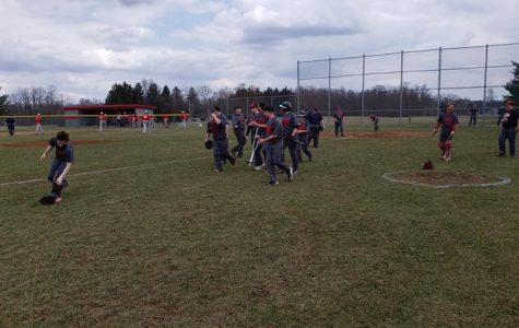 Baseball team rushing the field after the win.