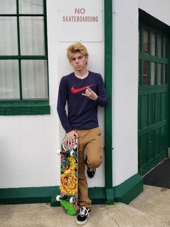 Adam Vealey with his skateboard.