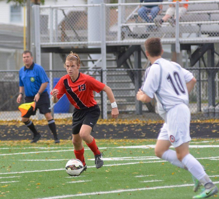 Jared Mount dribbles the ball