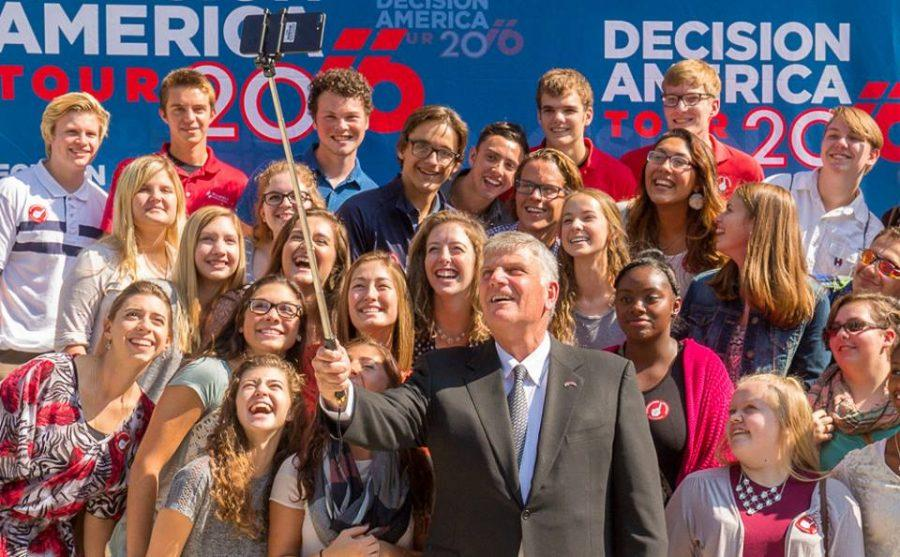 Franklin Graham poses with the Class of 2017