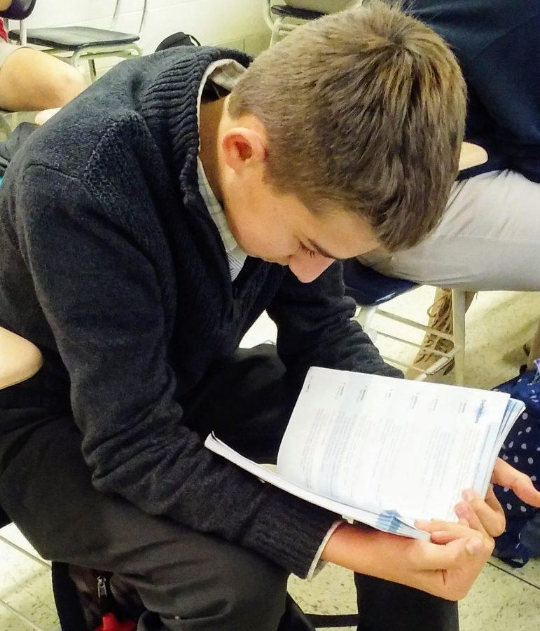 JC Mangan studying in class.