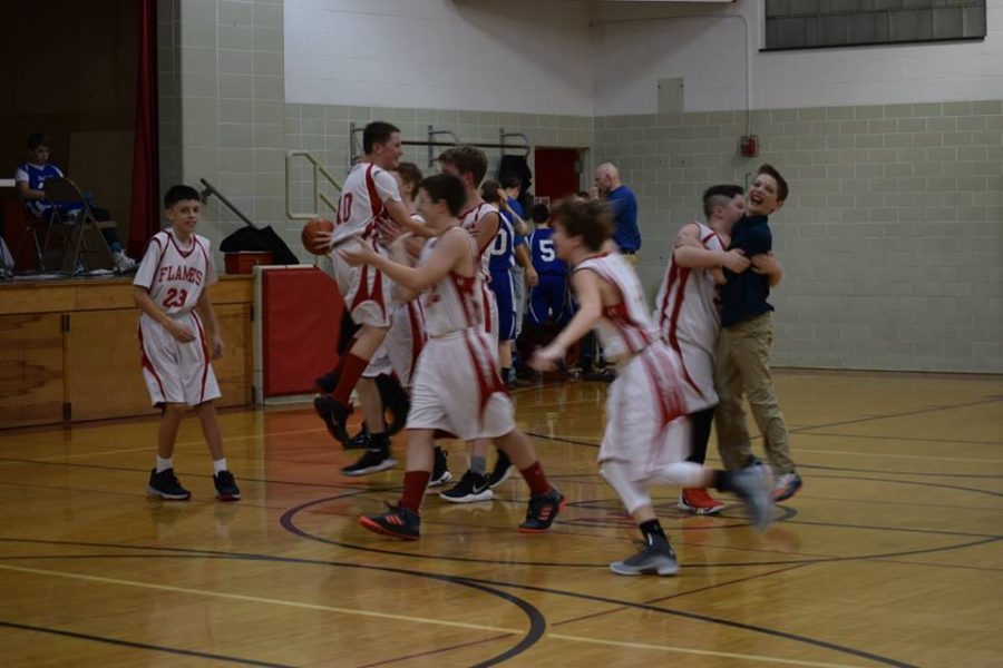 The team celebrates their first win of the season.
