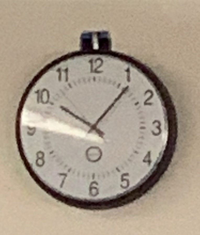 School clock that represents the time of the fires that occurred.
