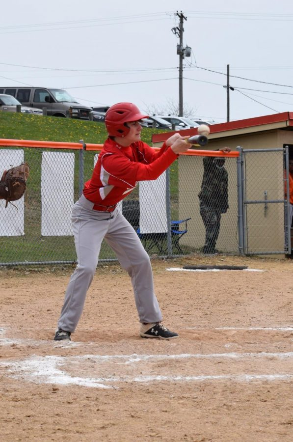 Bryce Courser bunting the ball vs Mansfield Senior
