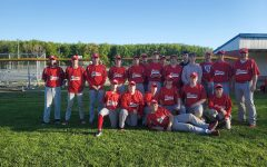 Baseball team poses after Oberlin win.